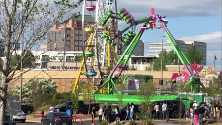 Families enjoy carnival rides in Atlanta