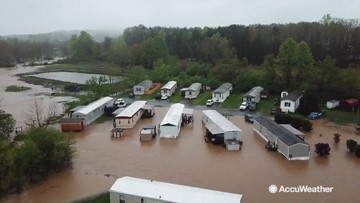 Homes overwhelmed by flash flooding in this drone video
