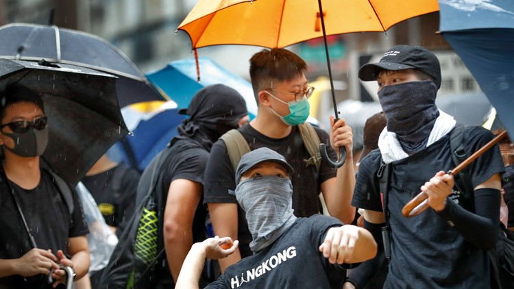 Hong Kong's divide: 1 protest for democracy, 1 for China