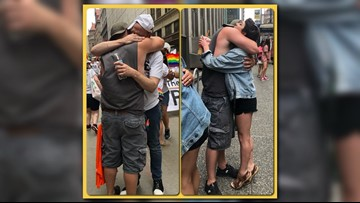Photos of dad giving hugs at Pride parade sparks emotional responses
