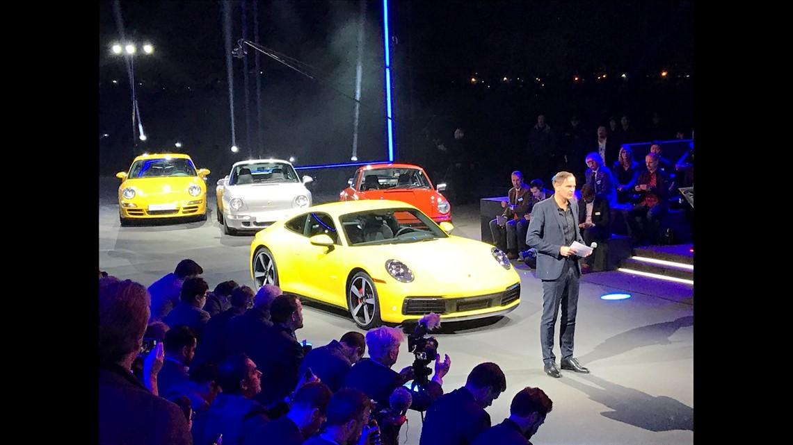 Porsche unveils new, longer 911 sports car