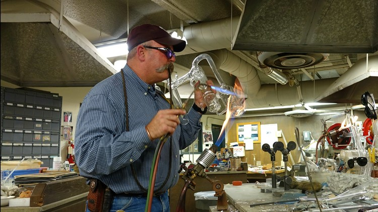 Here, beneath a campus rumbling with students, A&M's master glassblower transforms scientist's sketches into complex laboratory equipment.