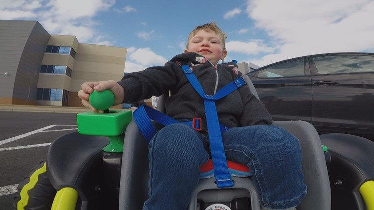 Two-year-old Cillian Jackson zooms around on the wheelchair built for him by the Farmington High School robotics team.