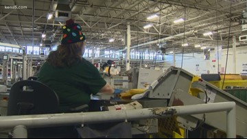 Inside a USPS distribution center on one of its busiest days