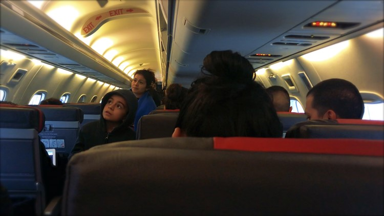 Anthony and Deysi Cabrera look for their assigned seats on flight from McAllen to Dallas