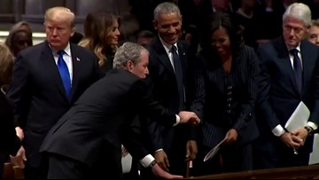 George W. Bush sneaks more candy to Michelle Obama at his father's funeral