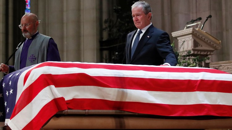 Former President George W. Bush touches the casket of his father_1544035684790