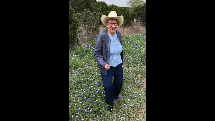 Eva Schloss in a field of bluebonnets