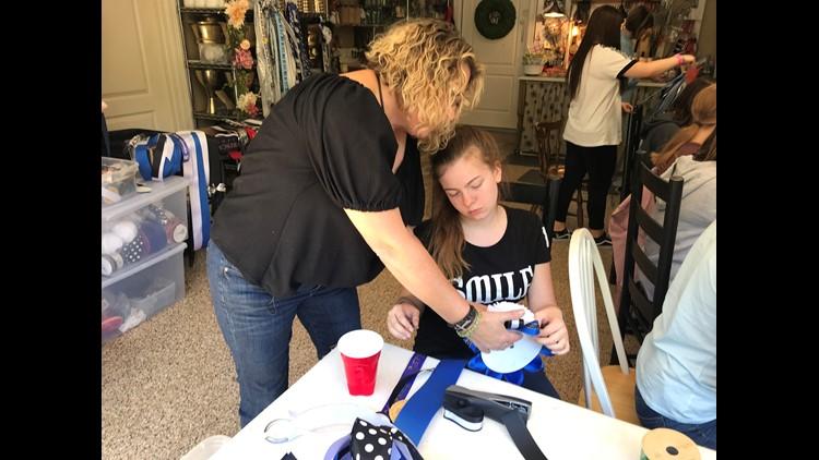 Diane Reis teaches German Exchange student Alma Luetzenbuerger how to make a mum