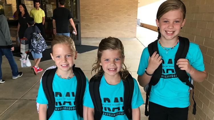 Girls wear 'Brave like Georgia' shirts on first day
