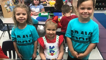 Students wear 'Brave Like Georgia' shirts in support of Whitehouse girl's first day