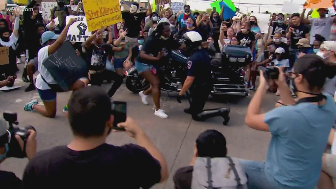 Small gesture in a difficult time: Arlington officer takes a knee during protest