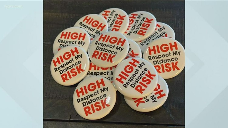 'Respect My Distance' pins remind others to social distance from high-risk individuals