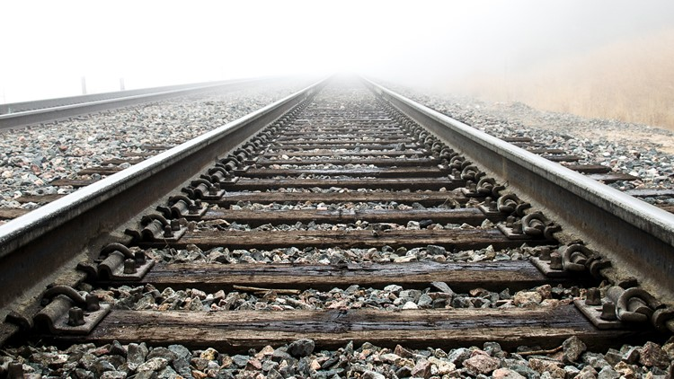 OFFICIALS: East Texas man dies after being struck by train while lying on train tracks